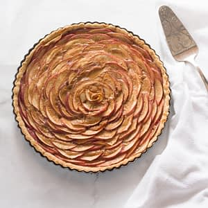 apple rose tart with dulce de leche kitchen towel and spatula