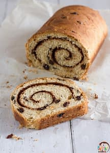 swirled raisin bread loaf with one slice