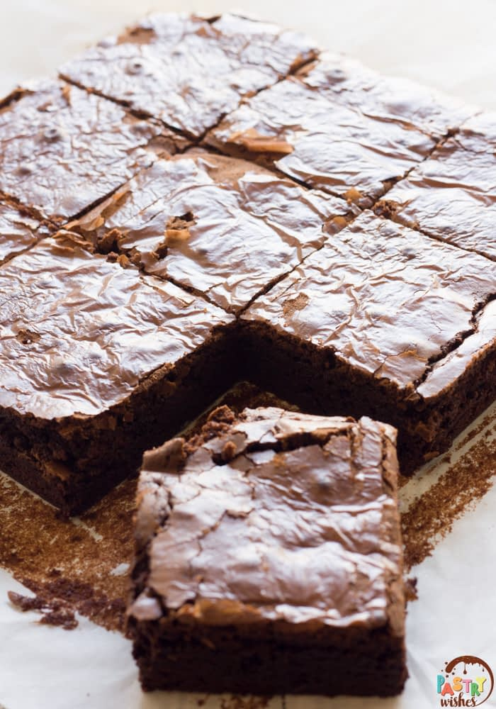 brownies cut into 9 squares on parchment paper
