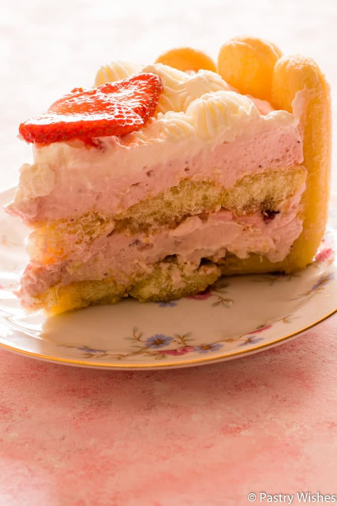 a slice of strawberry charlotte cake on a plate